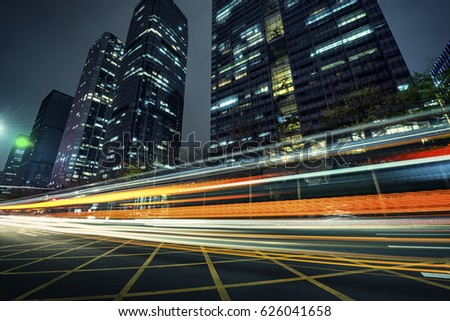 the light trails on the modern building background #626041658