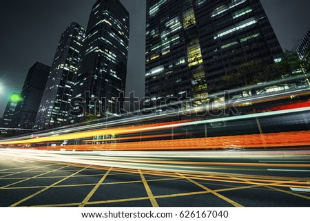 the light trails on the modern building background #626167040