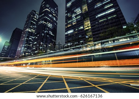 the light trails on the modern building background #626167136