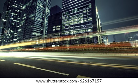 the light trails on the modern building background #626167157