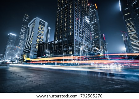 the light trails on the modern building background\r
