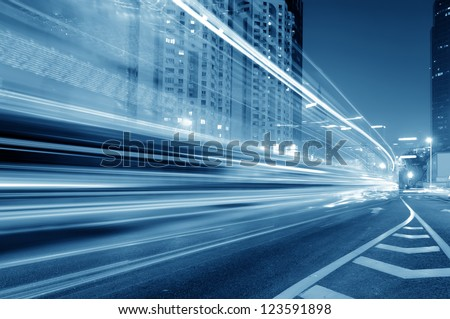 the light trails on the modern building background in shanghai china. #123591898