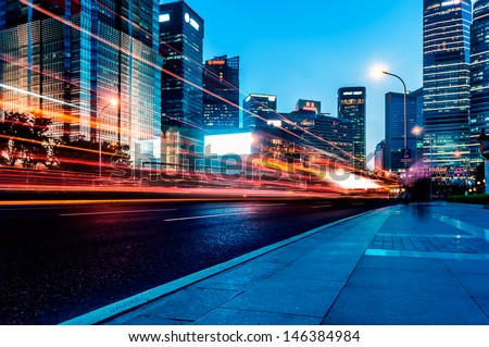 The light trails on the modern building background in shanghai china. #146384984