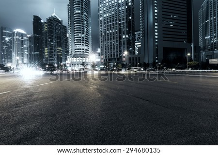 the light trails on the modern building background in shanghai china #294680135