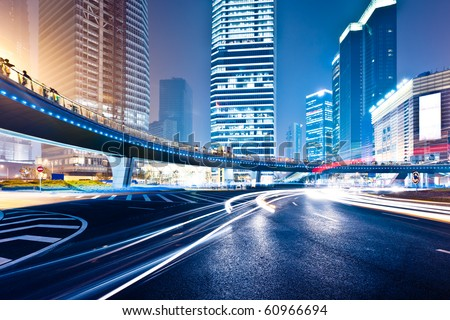 the light trails on the modern building background in shanghai china. #60966694