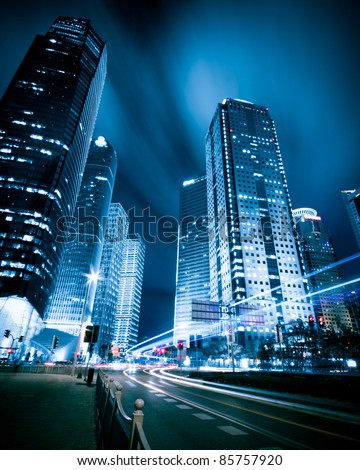 the light trails on the modern building background in shanghai china. - Shutterstock ID 85757920