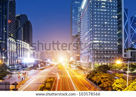 the light trails on the modern building background in shenzhen  china