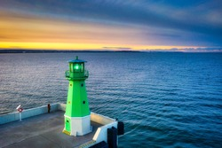 The lighthouse at the exit to the Baltic Sea in New Port at sunset, Gdansk. Poland