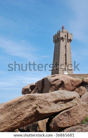 The lighthouse in Ploumenach in french brittany on pink granite rocks