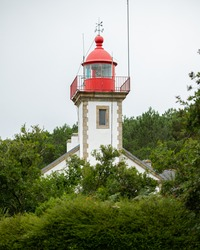 The lighthouse of Morgat (Brittany, France) on a cloudy day in late summer