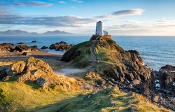 The lighthouse on Llanddwyn Island near Newborough on the Anglesey coast in Wales