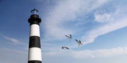 The lighthouse with soft blurry blue sky background. North Carolina's Bodie Island Lighthouse, USA.