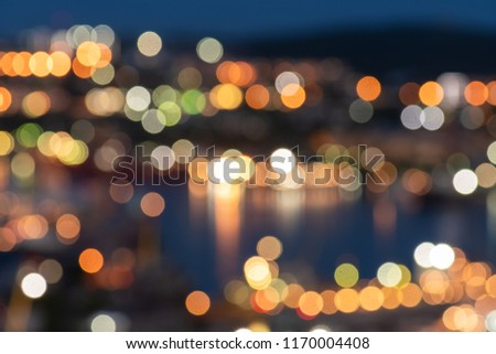 The lights of a night city in a defocused bokeh for a festive mood. Template for greeting card for entertainment and for creative projects #1170004408