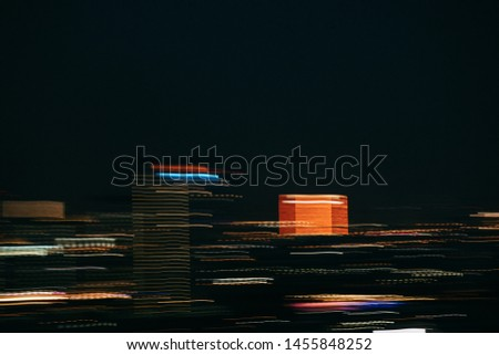 The lights of Bangkok at night and the blur colored skyline