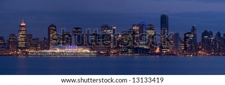 The lights of downtown Vancouver, Canada, at dusk. The city will be hosting the 2010 Winter Olympics. - stock photo
