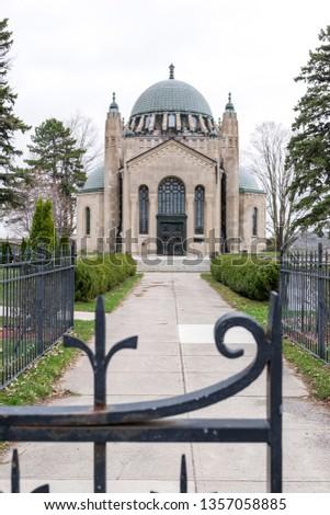 The limestone built copper topped exterior Thomas Foster Memorial located in Uxbridge, Ontario, Canada. #1357058885