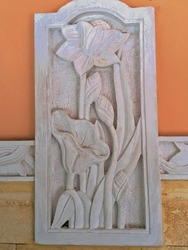 The limestone carved into a tree pattern makes for a beautiful home wall decoration