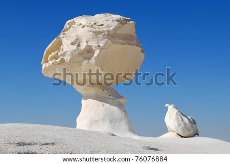 The limestone formation rocks like a mushroom and a chicken in the White desert, Sahara, Egypt
