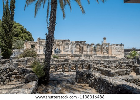The limestone White Synagogue over the ruins of the dark basalt rock village of Capernaum, on the shore of the Sea of Galilee, where Jesus and St Peter lived and met Andrew, James, John and Matthew