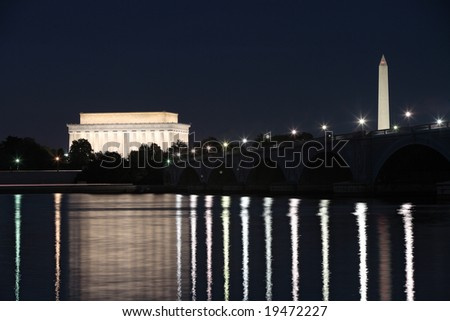 The Lincoln Memorial, Memorial Bridge and Washington Monument reflected in the Potomac River at night.