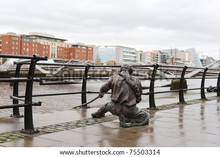 The Linesman statue situated on the bank of the River Liffey in the Financial district. Dublin, Ireland