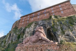 The Lion of Bartholdi against blue sky in Belfort, France