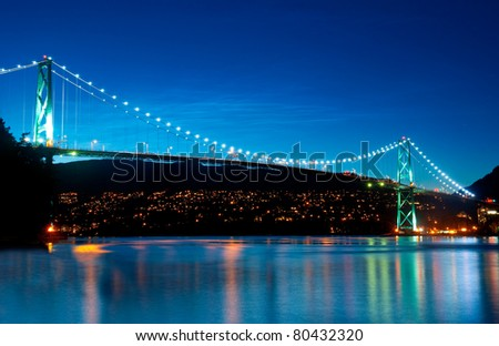 The Lion's Gate Bridge in Vancouver, British Columbia during an evening blue hour.
