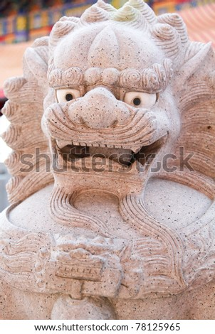 The lion statue on the Chinese Temple/The lion statue.