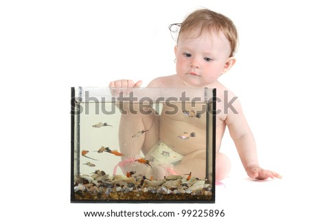 the little blue-eyed girl plays with small fishes in an aquarium. option 3