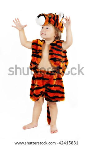 The little boy in a suit of a tiger with the lifted hands