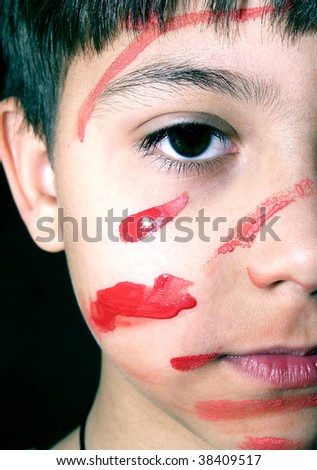 The little boy is smeared by a paint