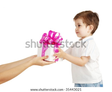 The little boy receives a gift from mum