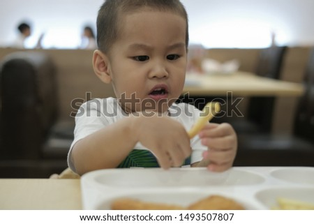 The little boy was eating lunch happily. happy a family time. #1493507807