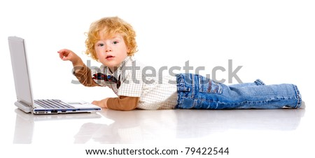The little boy with curly hair holds in hands notebook