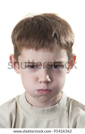 The little boy with inflated cheeks - stock photo