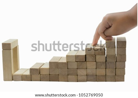 The little finger of the little boy, stepped up and down on the wooden stick, is a graph of business in abstract. with clipping path. #1052769050
