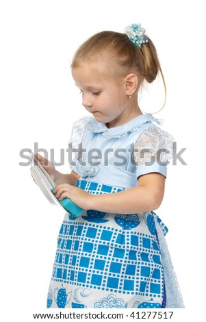 The little girl diligently washes with a sponge a plate on a white background. The mum\'s assistant.