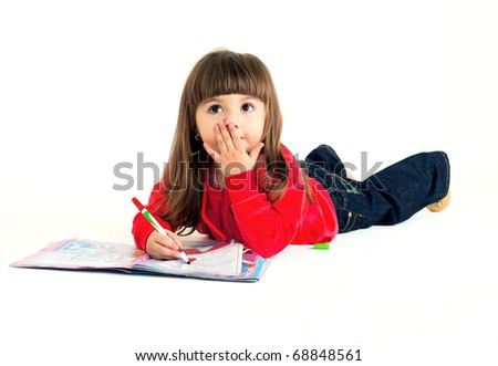 The little girl draws a picture felt-tip pens - stock photo