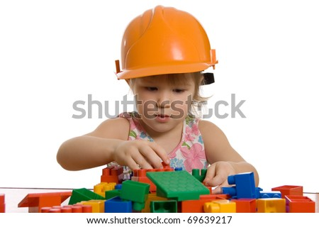 The little girl in a helmet plays