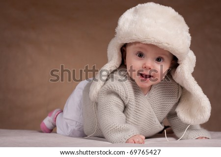 The little girl in a winter hat