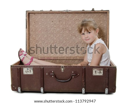 The little girl in an old suitcase - stock photo