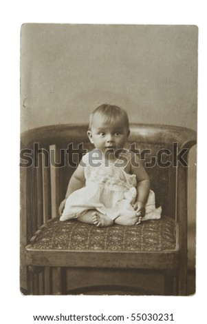 The little girl on a chair, an old photo