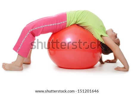 The little girl on a gymnastic ball