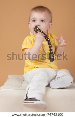The little girl pops in her mouth tape, a studio portrait - stock photo
