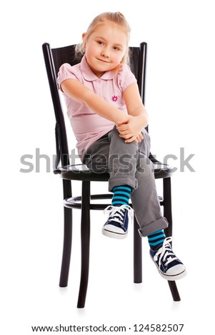 the little girl posing on antique chair