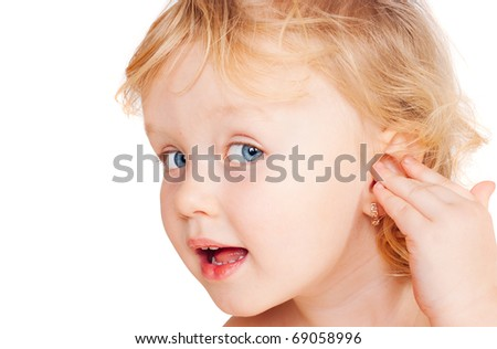 The little girl shows on an ear, a white background