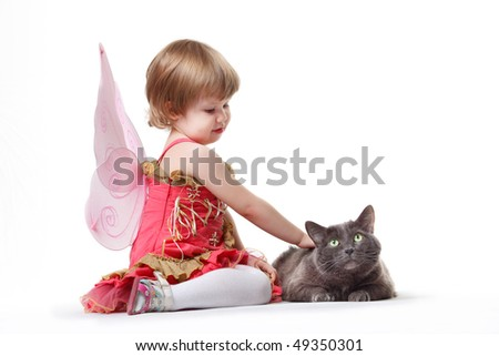The little girl with a cat