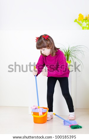 The little girl with a mop, bucket and  broom cleaning room