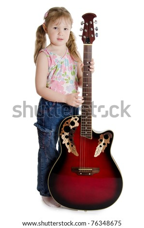 The little girl with an electric guitar
