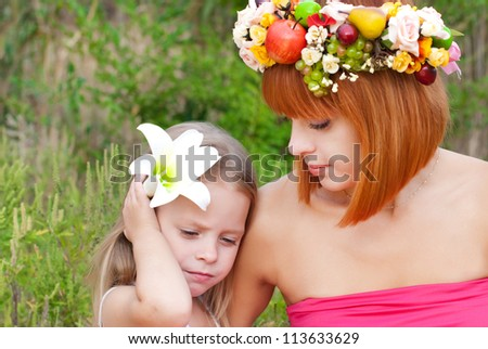 The little girl with mother outdoors